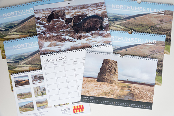 image of Northumberland calendars for 2019 with the double page on the left showing the March image and the single page on the right showing the September image