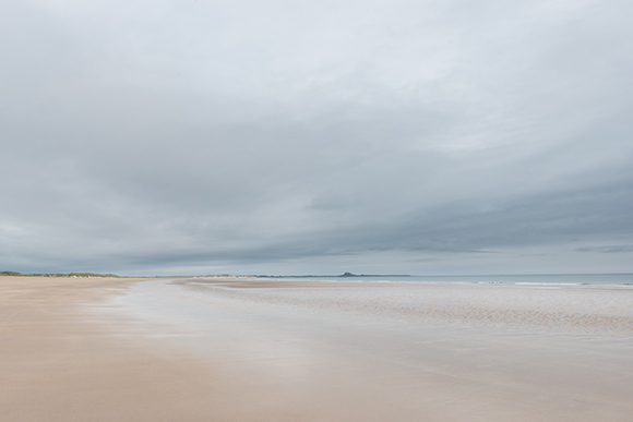 image of a distant Lindisfarne from Ross Sands