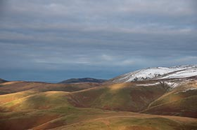 image of The Cheviot and The Schil at sunset with a touch of snow
