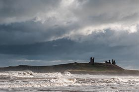 image of Dunstanburgh Castle on stormy day