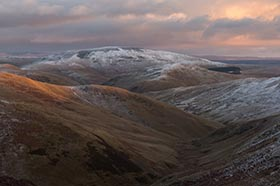 image of Shillhope Law with a dusting of snow and the valley of the Rowhope Burn at sunset